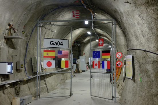 The picture shows the entrance to the rock laboratory with the flags of all patners at the door.