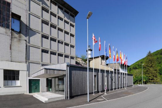 Exterior view of the visitor center behind the various national flags of our project partners